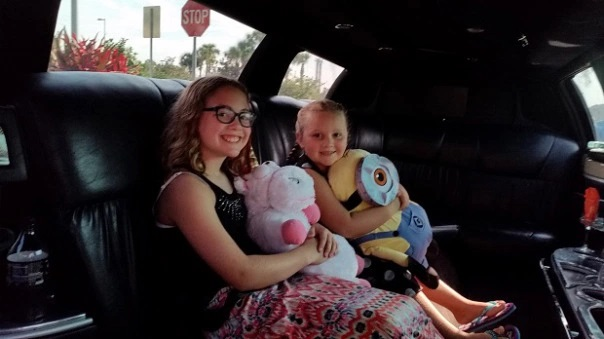 Happy Children in Limo Going to Airport