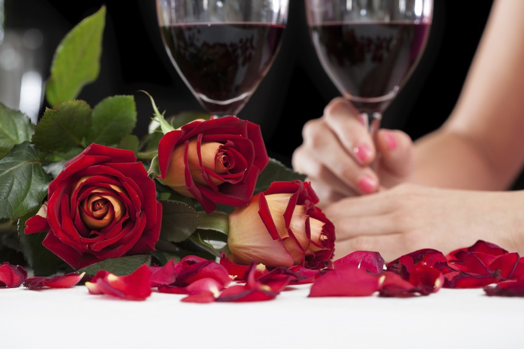 Close up of beautiful red roses and glasses with wine - Limo Dinner Minneapolis MN