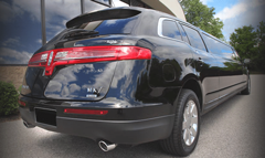 Black Lincoln MKT Stretch Limo Rear Sideview - Minneapolis
