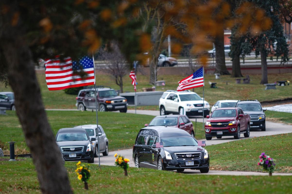 Funeral Procession Vehicles Entering a Cemetary | Aspen Limo Funeral Limousine Car Services in Minneapolis St Paul MN Area